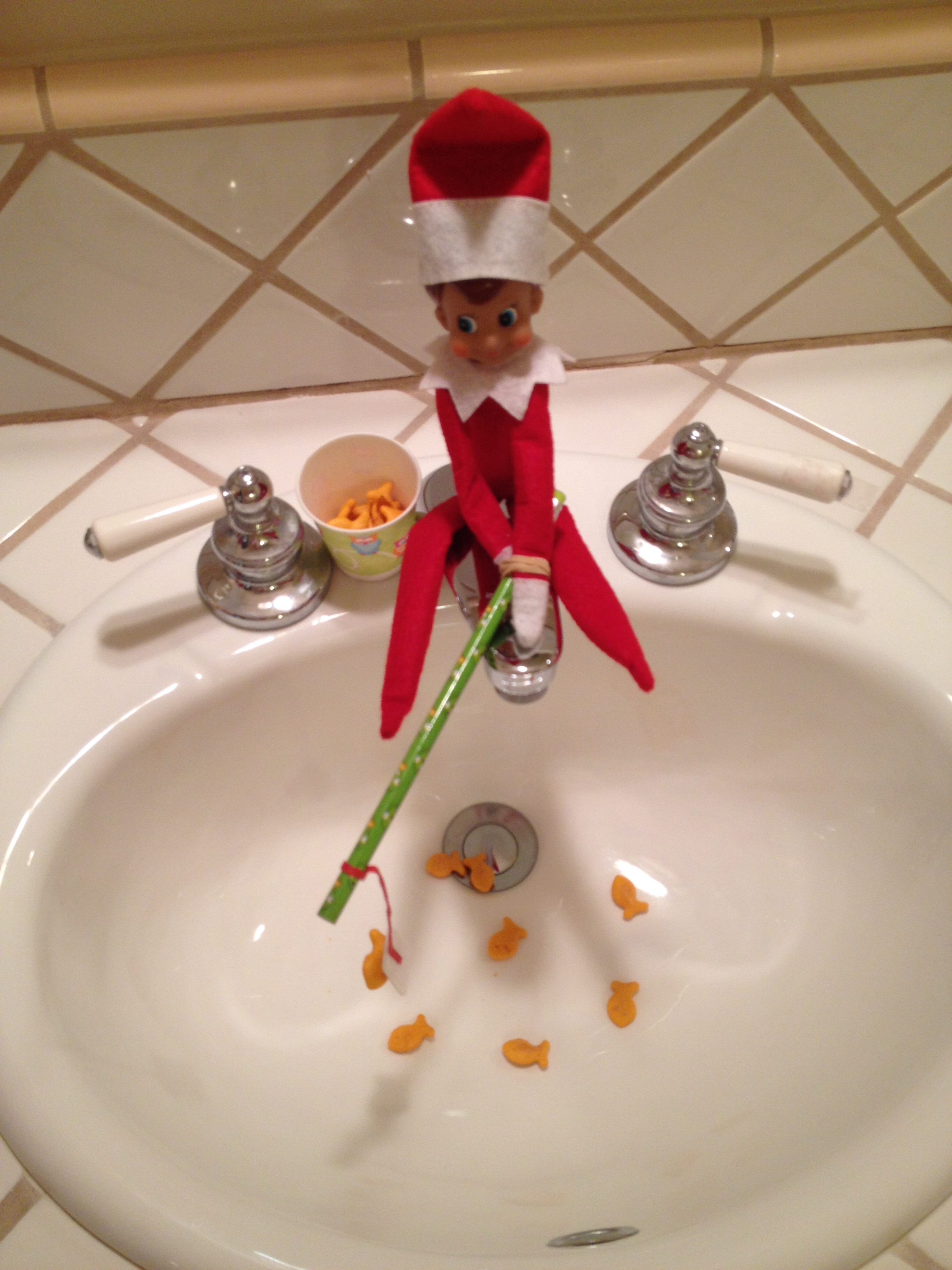 Christmas the fairly good mother for Elf on the shelf pooping on cookies
